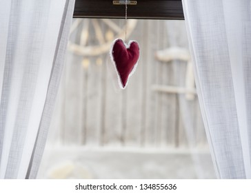 heart over grey wood background