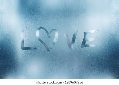 The heart is painted on the misted glass in the winter.