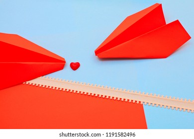 heart and paper airplanes on red and blue background