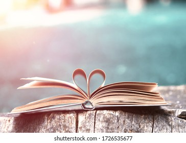 heart of paper book on wood in nature
