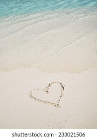 Heart picture draw on the white sand beach