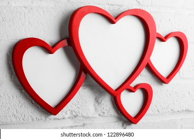 heart picture frame on white wall,valentine decoration.