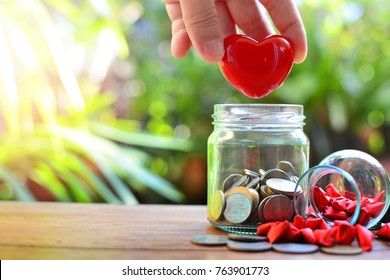 heart putting in saving glass bottle for concept health care  and philanthropy