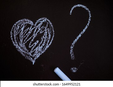 Heart with a question mark on a black background.