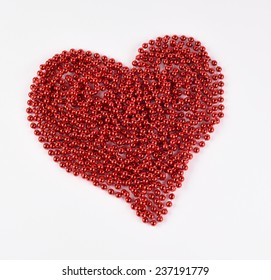 Heart red bead of white background