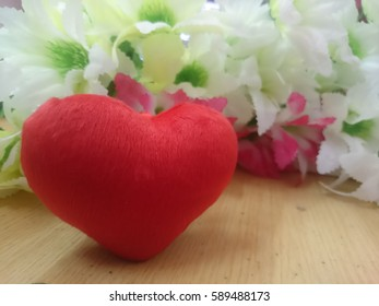 heart red color with blur flowers background