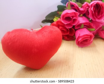heart red color with blur rose background