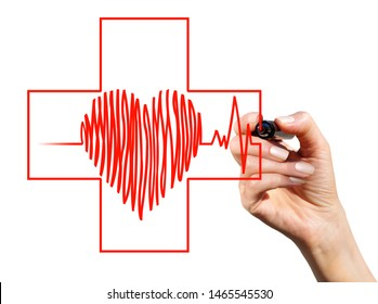 The heart and the red cross are drawn with a marker in a woman's hand. Healthcare concept.
