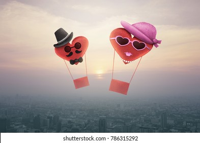 Heart red love ballon character man and woman over aerial view of cityscape at sunset, vintage style, Valentines day concept