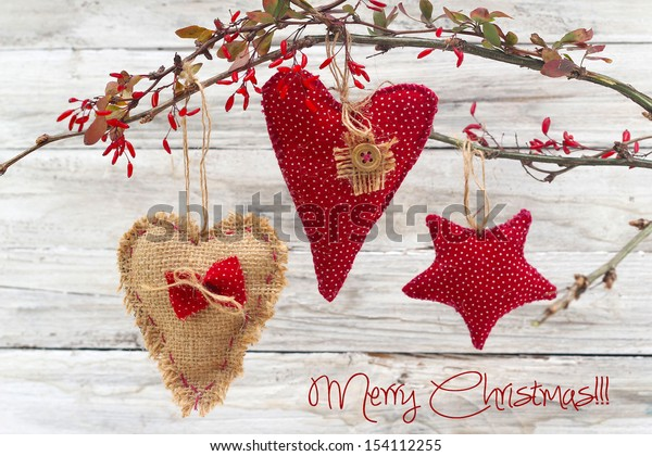 heart and red stars on wooden background