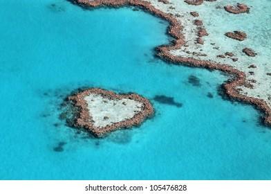 Heart reef impact in the tropical blue ocean