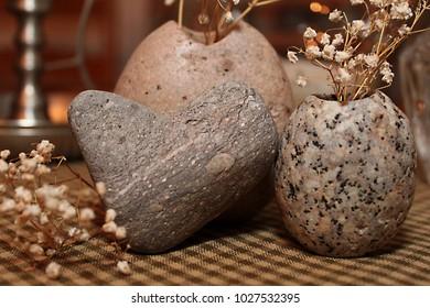 Heart rock closeup with dried flower arrangement