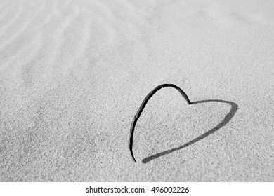 Heart in sand black and white