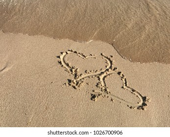 heart in the sand, the sea washes, summer