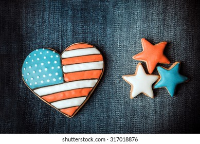 Heart shape american flag with patriotic ginfer stars for the 4th of July on the blue denim background with vignette