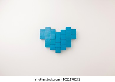 heart shape from array blue block toy on white paper background with copy space