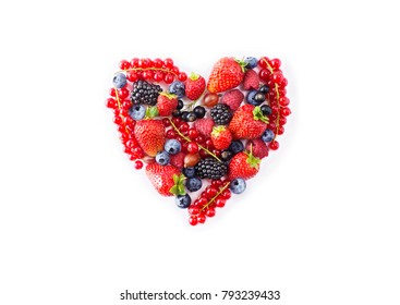Heart shape assorted berry fruits on white background. Black-blue and red food. Mixed berries with copy space for text. Various fresh summer berries. Berries in heart shape isolateed on a white.