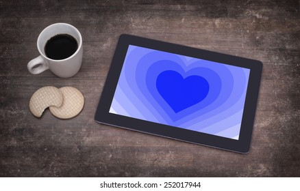 Heart shape backgound on a tablet - Concept of love - blue