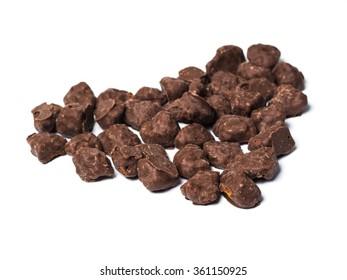 Heart shape Black Chocolates on white isolated background.