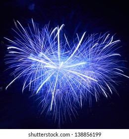 Heart shape of blue colorful fireworks on the black sky background