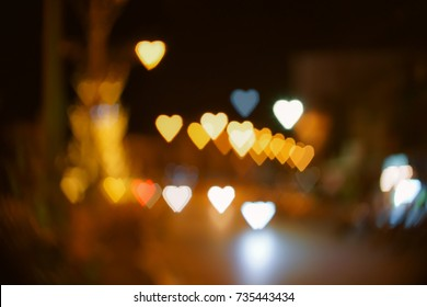 Heart shape bokeh from street light background, Love heart background