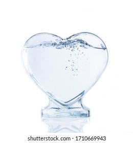 Heart shape bottle of water with bubble on white background.