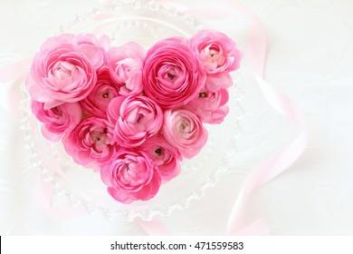 Heart shape bouquet of pink ranunculus