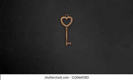 Heart Shape Brass vintage key on dark background