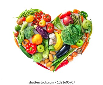 Heart shape by various vegetables and fruits. Healthy food concept. Isolated on white background