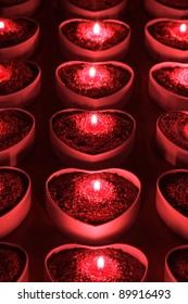 Heart shape candle holders with lighted candles inside
