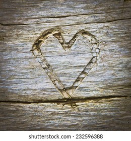 Heart shape carved into wood