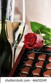 Heart shape chocolate, champagne  and red rose