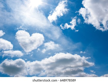 heart shape cloud in blue sky background with space for text