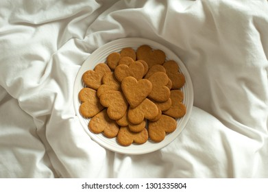Heart shape cookies on white bed