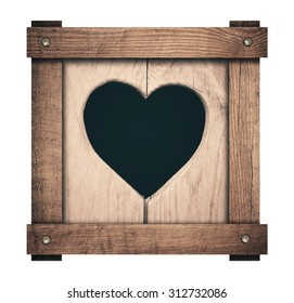 Heart shape cut on wooden planks and screwed frame