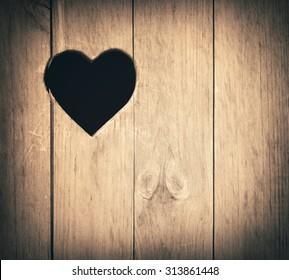 Heart shape cut on wooden wall, toilet, wc door or window