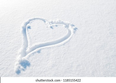 The heart shape drawn on snow.