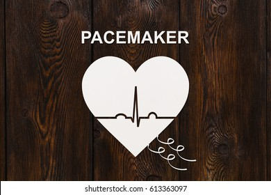 Heart shape with echocardiogram and PACEMAKER text. Medical cardiology concept.