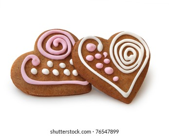 Heart shape ginger breads decorated with pink and white sugar glazing
