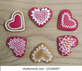 Heart shape gingerbread on wooden background