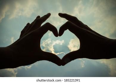 heart shape hand silhouette on sky outdoor