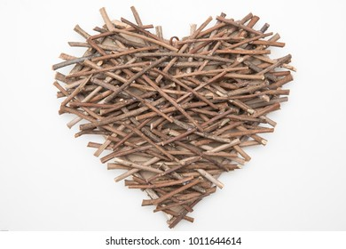 Heart shape handcraft made from small dry branch, on white background