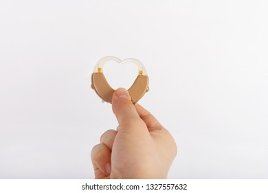 Heart shape from hearing aids formed by a hand
