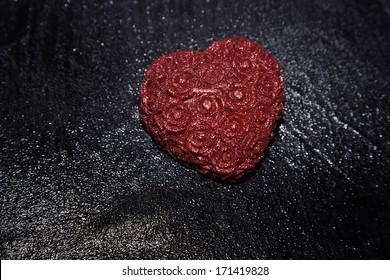 Heart shape in heavy rain. Close-up view
