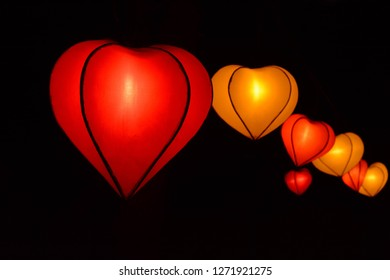 heart shape lampion lantern at park at night time isolated in black