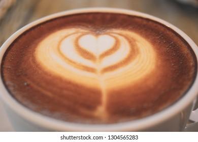 heart shape latte art of coffee