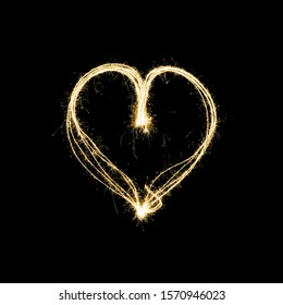 heart shape light painting with sparklers isolated on black background - symbol for love and romance