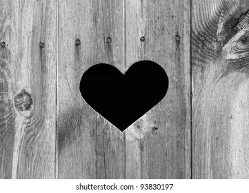 Heart shape look out on wooden door to outhouse. bleach,