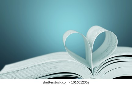 Heart shape made of book pages