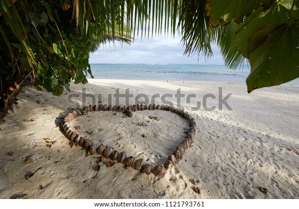 A heart shape made from coconuts on a beach in Rarotonga, the main island of the Cook Islands, South Pacific.